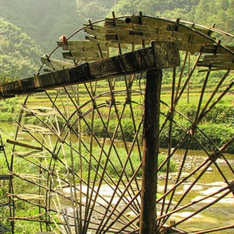 Chase | China - C1350 Water wheels irrigate the rice paddies