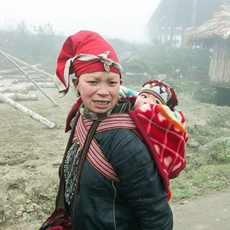 Chase | Vietnam - D575 Mom carrying baby